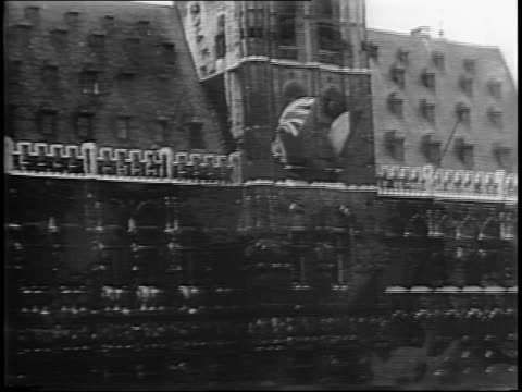 government building adorned with british and belgian flags / mayor of brussels greets allied ttoops / montage of nazi prisoners marching as women... - intricacy stock videos & royalty-free footage