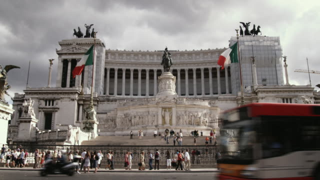 ws la government building with traffic passing by / rome, italy - politics stock-videos und b-roll-filmmaterial