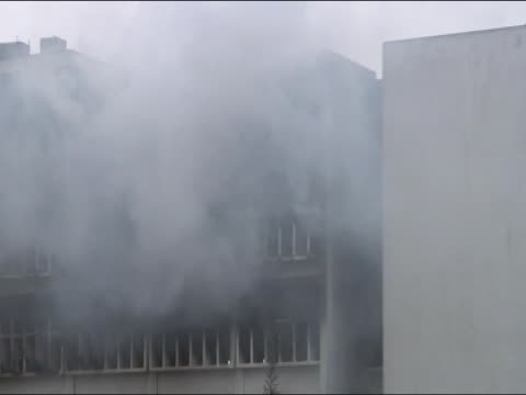 Government buildings ablaze during the uprising in Libya
