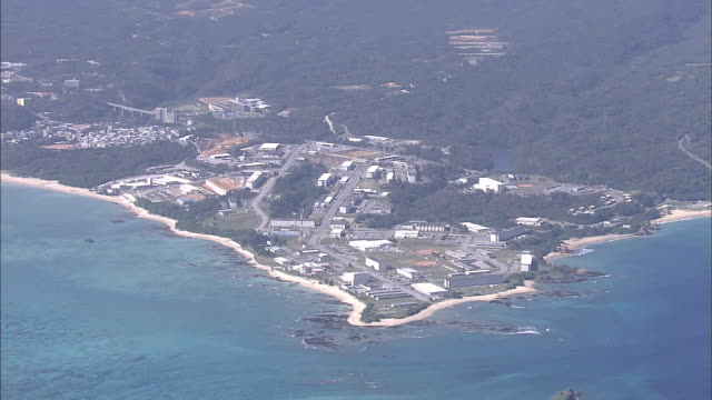 Government buildings front Oura Bay at Camp Schwab in Nago, Okinawa.
