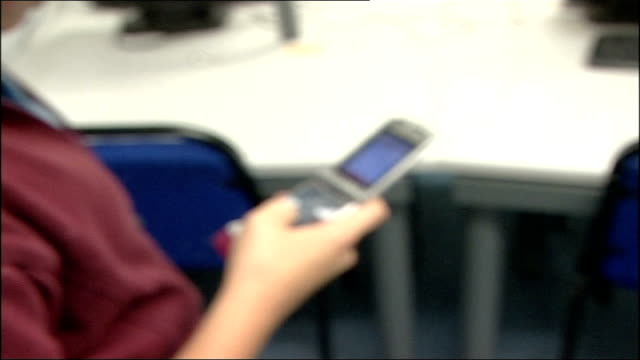 Government campaign against 'cyber bullying' Bristol INT Schoolchildren using mobile phones to text in classroom