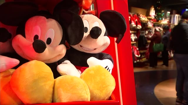 Government clears way for Sky bidding war TX London INT Mickey Mouse soft toys in toy shop Snow White 'dwarf' soft toy