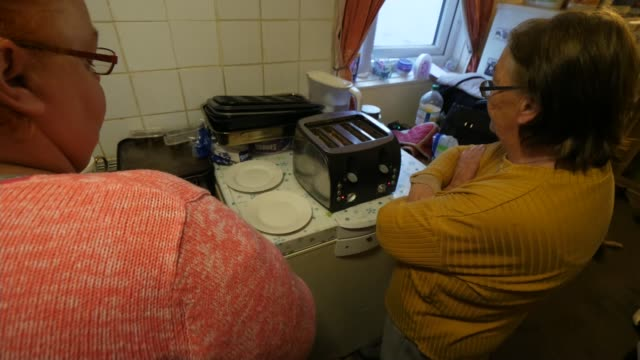 government considers decriminalising nonpayment of tv license fee england ext gv front of house kim watts and her mum in kitchen close shot kim watts... - jackie long stock videos & royalty-free footage