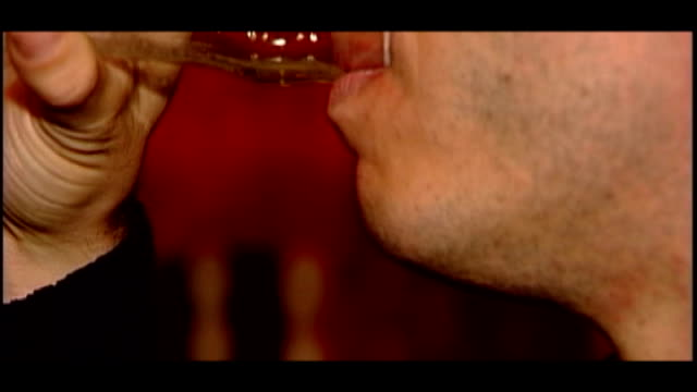 government criticised over minimum price increases to alcohol file / dates locations unknown int close shots of men drinking alcohol from glasses and... - lager stock videos & royalty-free footage