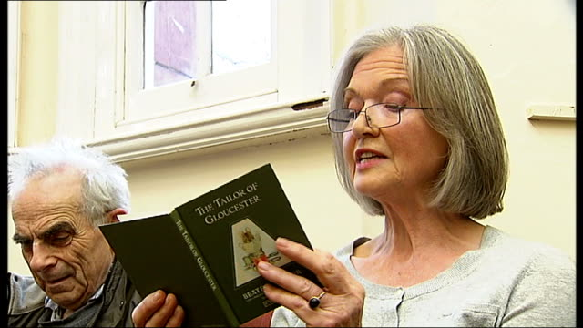 protests against library closures; anna ford reading from beatrix potter book at 'read-in' sot - anna ford stock videos & royalty-free footage