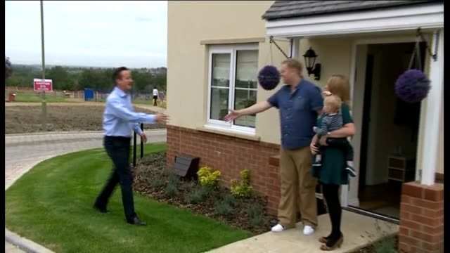 government discount starter home plan oxfordshire didcot ext david cameron mp shaking hands with family outside house in new housing development - didcot stock videos and b-roll footage