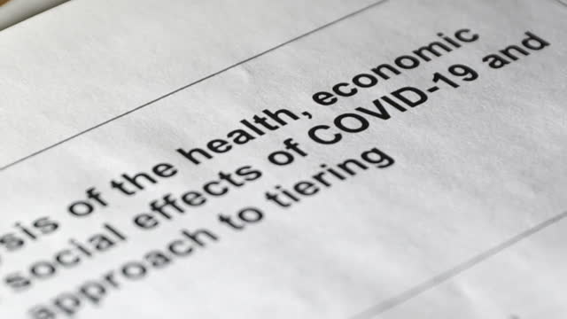 government document showning analysis into the coronavirus tiering system - analysing stock videos & royalty-free footage