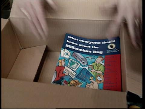 vídeos y material grabado en eventos de stock de government 'don't panic' campaign itn england int government booklets designed to allay fears over millennium bug along at printers cms booklets... - el milenio