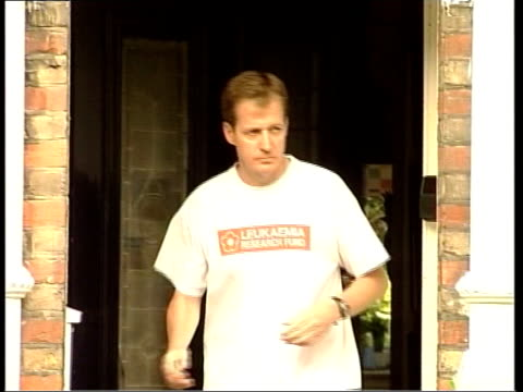 government dossier: campbell/bbc row; itn england: london: ext alastair campbell towards from house campbell jogging away down street - file stock videos & royalty-free footage