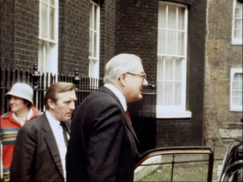 stockvideo's en b-roll-footage met james callaghan departs downing street england london downing street ext james callaghan mp along from number 10 waving says good afternoon and thank... - downing street