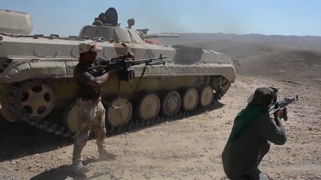 government forces and the hashed al shaabi an alliance mostly of shiite militias are fighting to retake the northern town of hawija after expelling... - shi'ite islam stock videos & royalty-free footage