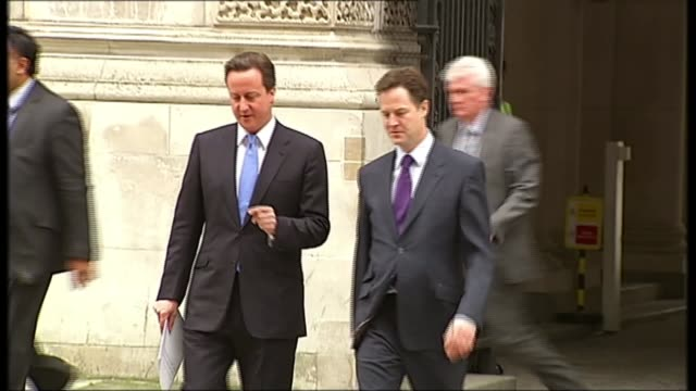 government gives goahead to third runway at heathrow airport 2052010 / r20051009 london hm treasury ext david cameron mp and nick clegg mp departing... - ニック クレッグ点の映像素材/bロール