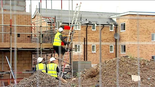 government hails success of right to buy scheme / affordability of houses location unknown ext row of new houses construction worker climbing ladder... - ladder of success stock videos & royalty-free footage