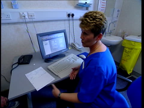 government health service reforms announced / another leak to press england northumbria north tyneside general nurse speaking to woman holding little... - cut video transition stock videos and b-roll footage