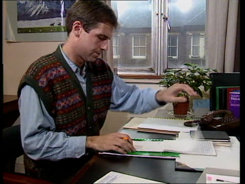 stockvideo's en b-roll-footage met government makes changes in probation services int cms booklet 'napo provation directory 1989' pull out as paul doran sits at his desk and starts to... - probatie