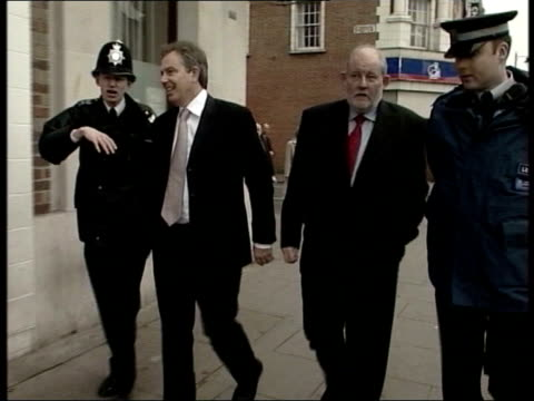 government ministers advised to drink more; date unknown tony blair mp and charles clarke mp walk along street chatting to two police officers - charles clarke uk politician stock videos & royalty-free footage