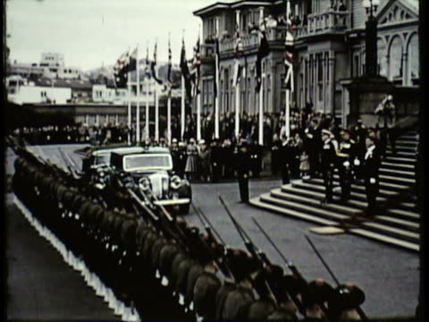 1955 MONTAGE PAN WS MS HA Government official arriving at Parliament building, crowd cheering / New Zealand / AUDIO