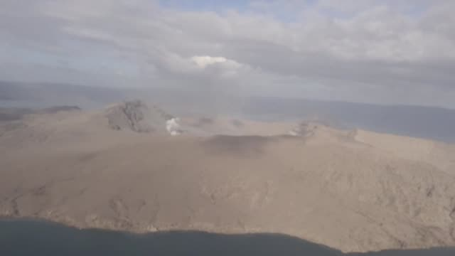 government officials conduct an aerial inspection of the rumbling philippine volcano as the threat of a more powerful eruption remains high - erupting stock videos & royalty-free footage