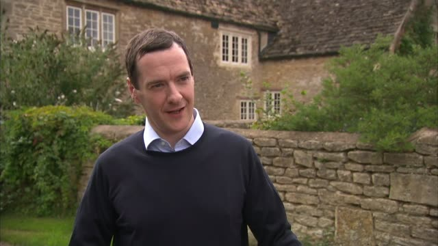 government outline plans for affordable homes in the countryside; wiltshire: ext george osborne mp interview sot - we want to see our countryside... - tetto di paglia video stock e b–roll