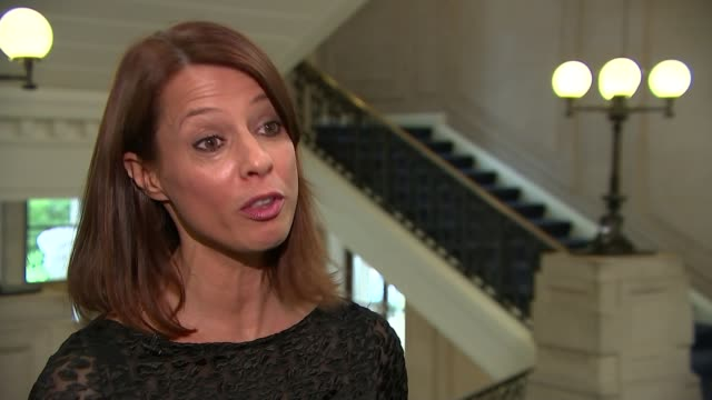 government outlines plans to tackle gender pay gap; int gloria de piero mp interview sot ext statue of emmeline pankhurst pull out reporter to camera - gloria de piero stock videos & royalty-free footage
