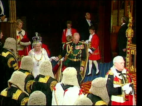 government plans a new agency to regulate quality and safety lib house of lords queen elizabeth ii and prince philip along into chamber for state... - the queen's speech state opening of uk parliament stock-videos und b-roll-filmmaterial