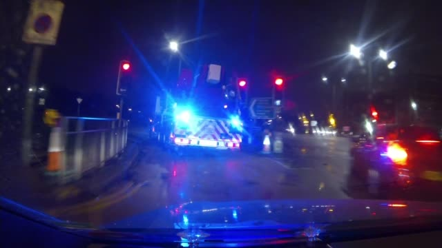 government plans for major shake up of the fire service; t06111528 / 6.11.2015 london: at night blue light flashing atop fire engione as along street... - major road点の映像素材/bロール