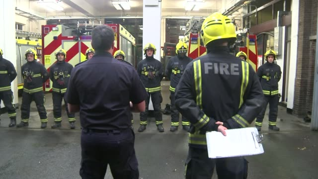 government plans for major shake up of the fire service t06111528 / 6112015 england london wembley ext at night various of firefighters lined up... - politics and government stock videos & royalty-free footage