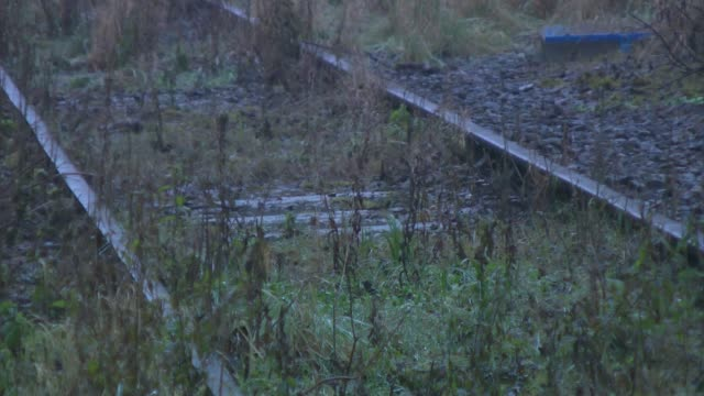 Government plans for private companies to take over rail lines comes under fire Buckinghamshire Winslow Muddy puddles on disused railway track line...