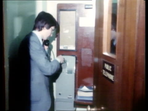 stockvideo's en b-roll-footage met government plans for privatisation of british telecom tx london man using pay phone - british telecom