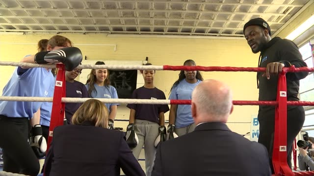 government plans to involve more people in sport and fitness; england: london: int woman punching pads held by trainer tracey crouch mp chatting to... - boxing women's stock videos & royalty-free footage