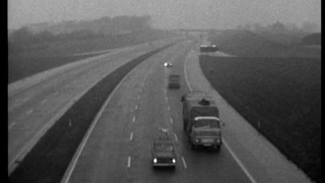 government plans to raise motorway speed limit to 80mph 1965 / x10116501 from car as travelling along motorway light traffic b/w high angle shot of... - travelling light stock videos & royalty-free footage
