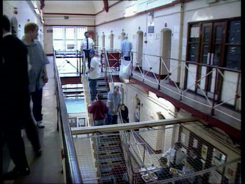 government plans to reform the justice system sentencing changes lib gvs prisoners along up steps in prison atrium legs of prisoners in canteen - prison reform stock videos & royalty-free footage