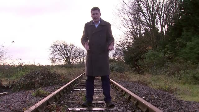 Government plans to reopen rail lines closed in 1960s by infamous Beeching report ENGLAND Buckinghamshire Town square Church tower and trees River...