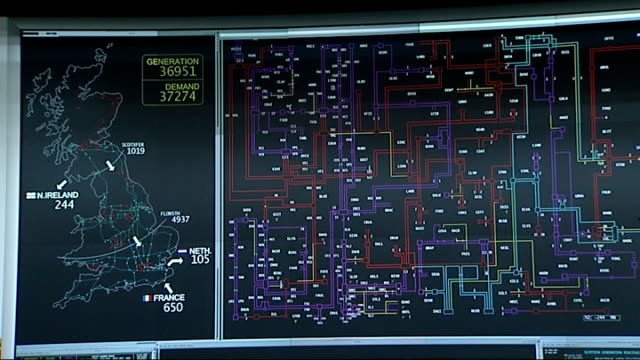 Government plans to reward energy efficiency R12071112 Reading National Grid HQ Various of displays showing the national grid levels of power...