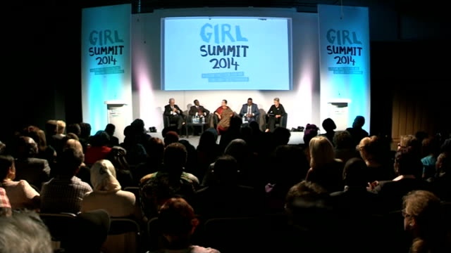 government plans to try to stop practice of female genital mutilation int various of people on stage at 'girl summit 2014' - mutilazioni genitali femminili video stock e b–roll