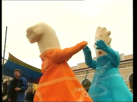 government plays down bomb blasts itn athens two foam mascots practising dance routine - 2004 stock videos and b-roll footage