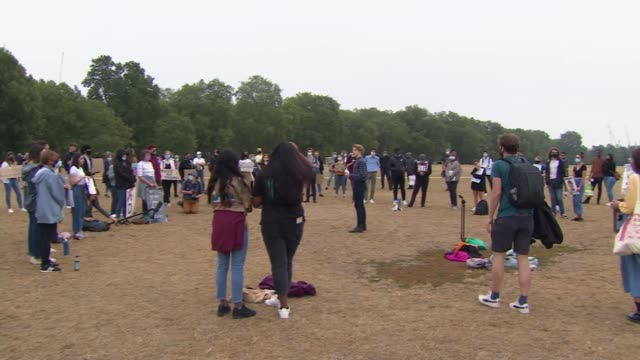 government promises to pay for all students who wish to appeal a level results; england: london: hyde park: ext protesters wearing masks holding... - distant stock videos & royalty-free footage
