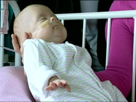government recommendations on abortion england midlands baby millie mcdonagh in her cot in special care unit with her family beside - abortion stock videos and b-roll footage
