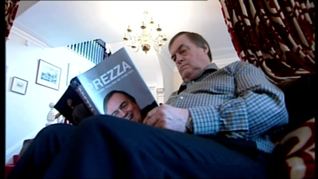 stockvideo's en b-roll-footage met government reform of elderly and disabled social care promised lib hull int setup shots of john prescott sitting at home looking at his autobiography... - autobiografie