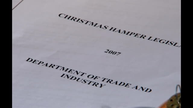 government reforms to stop repeat of farepak scandal london document entitled christmas hamper legislation 2007 display featuring farepak hamper with... - hamper stock videos and b-roll footage