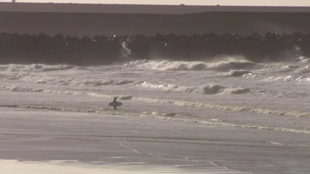government refuse to back swansea bay tidal lagoon project uk wales swansea bay library footage 2016 waves crashing on aberavon beach port talbot... - lagoon stock videos & royalty-free footage