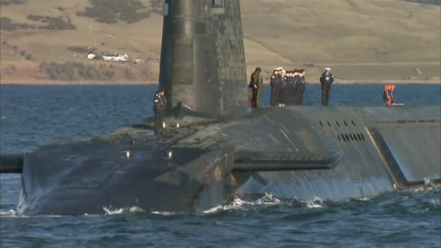 government refuses to report operational details over trident missile malfunction lib / en route to faslane various shots of submarine hms victorious... - trident stock videos & royalty-free footage