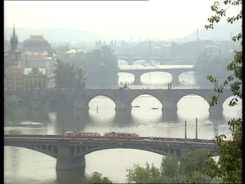 stockvideo's en b-roll-footage met government resists reforms czechoslovakia prague ext bridges over vltava river street as st vitus' cathedral in background head of statue with halo... - praag
