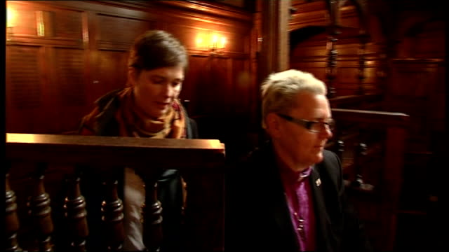 stockvideo's en b-roll-footage met government reveals gay civil marriage proposals england int sharon ferguson entering church with her female partner and standing before altar saron... - altaar