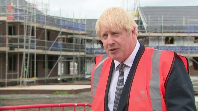 government reveals plans for sweeping changes to planning laws in england england cheshire ext general views of boris johnson mp doing brickwork on... - {{relatedsearchurl(carousel.phrase)}}点の映像素材/bロール