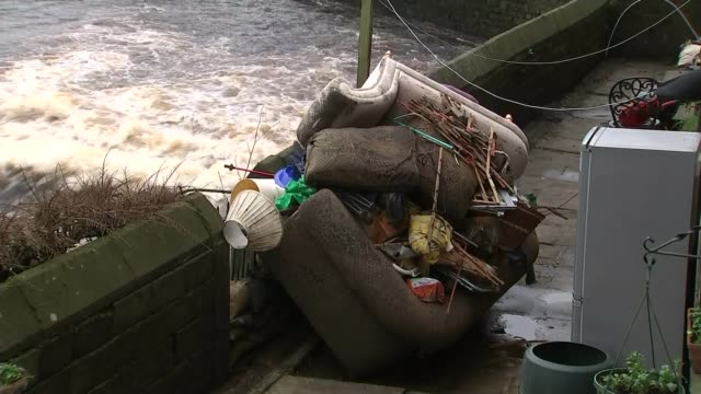 vidéos et rushes de government review into flooding condemmed as promising a 'sticking plaster' on future prevention / flood damaged furniture on path beside river... - pansement médical