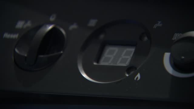 government sets out details of energy price cap r18021619 / int close shot of blue gas flame on hob close shot control switch siemens thermostat hand... - knob stock videos and b-roll footage