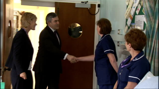 gordon brown and ed balls visit health centre in leatherhead england surrey leatherhead ext car arrives as gordon brown mp out of car and greets... - gordon brown stock videos & royalty-free footage