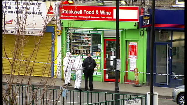 fears that funding for operation trident will be hit tx south london stockwell general views police at scene of shooting of thusha kamaleswaran - ストックウェル点の映像素材/bロール