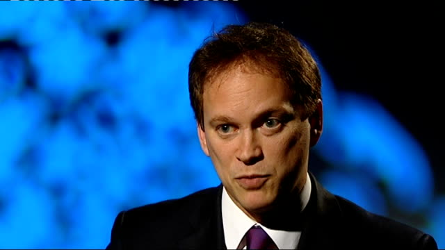 manchester council announces range of cuts location unknown int grant shapps mp interview sot not neccessary to make frontline cuts in manchester /... - face down stock videos & royalty-free footage